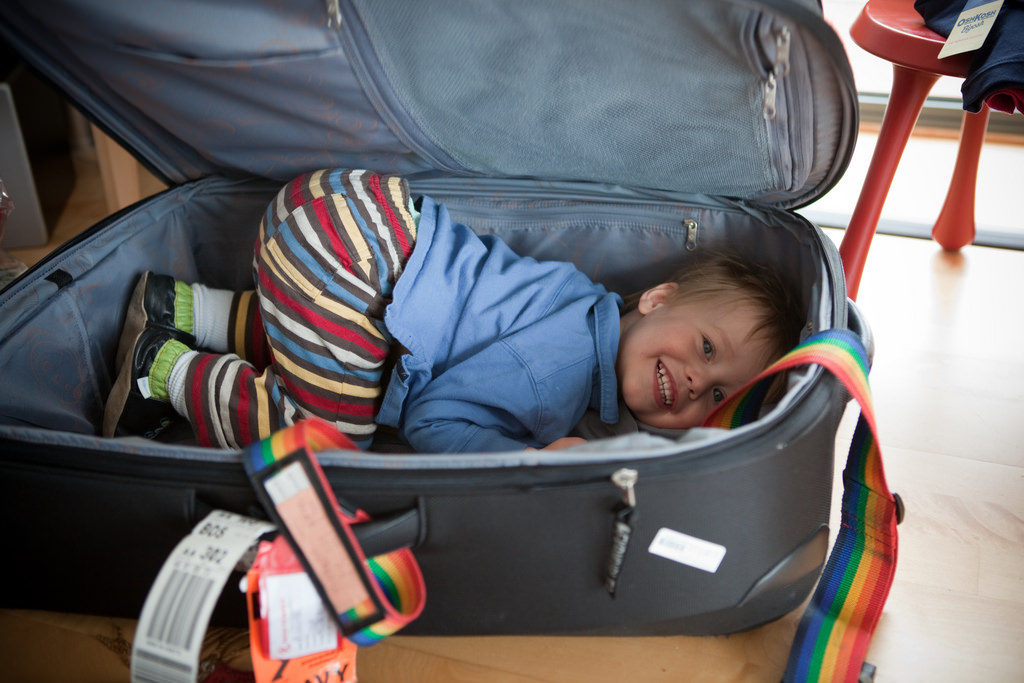 Boy in suitcase