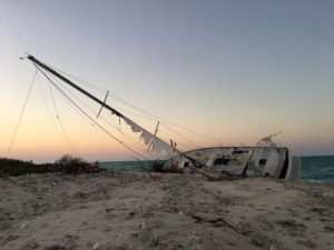 sailboat wrecked on the beach